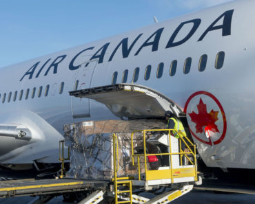 Worker loads cargo into Air Canada jet
