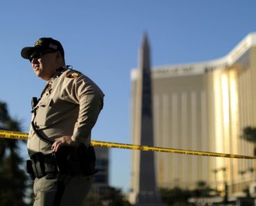 A police officer stands in front of the closed Las Vegas Strip next to the site of the Route 91 music festival mass shooting outside the Mandalay Bay Resort and Casino in Las Vegas, Nevada, October 3, 2017.