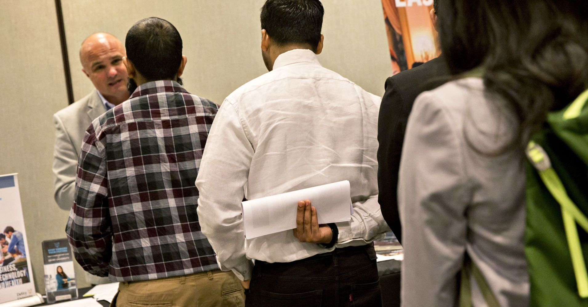 Job seekers wait to speak to a representative during a Coast-to-Coast Career Fair in Chicago, Illinois.